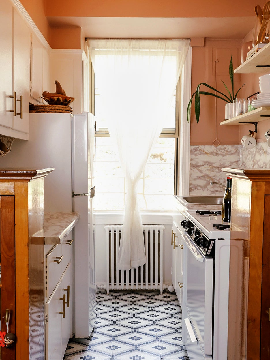 Pink Paint and Hardware Store Shelves Made This Rental Kitchen Unrecognizable