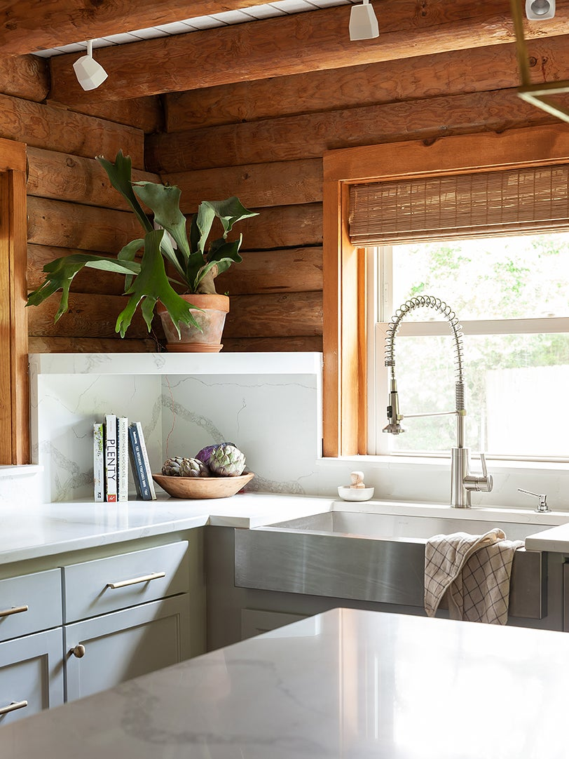 corner of gray kitchen with raw wood siding on walls