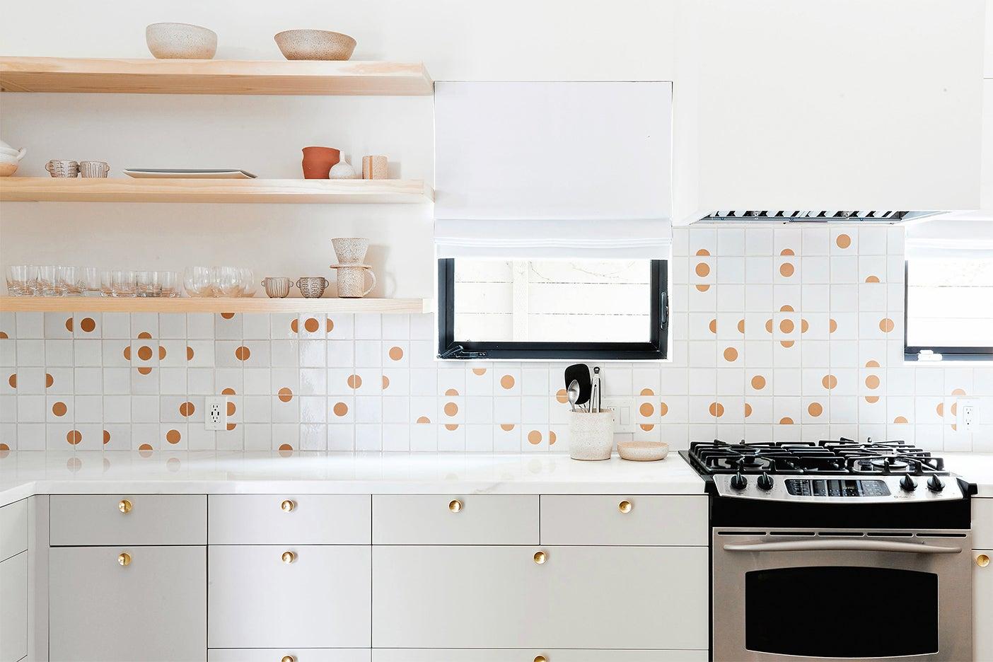 gray kitchen with geometric tile backsplash