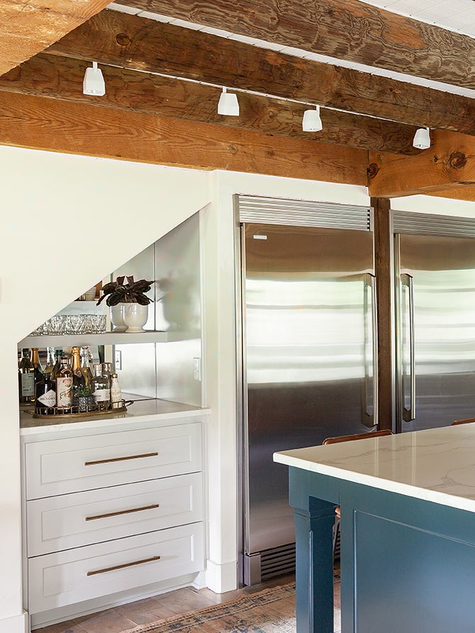 gray kitchen with slanted bar cabinet nook