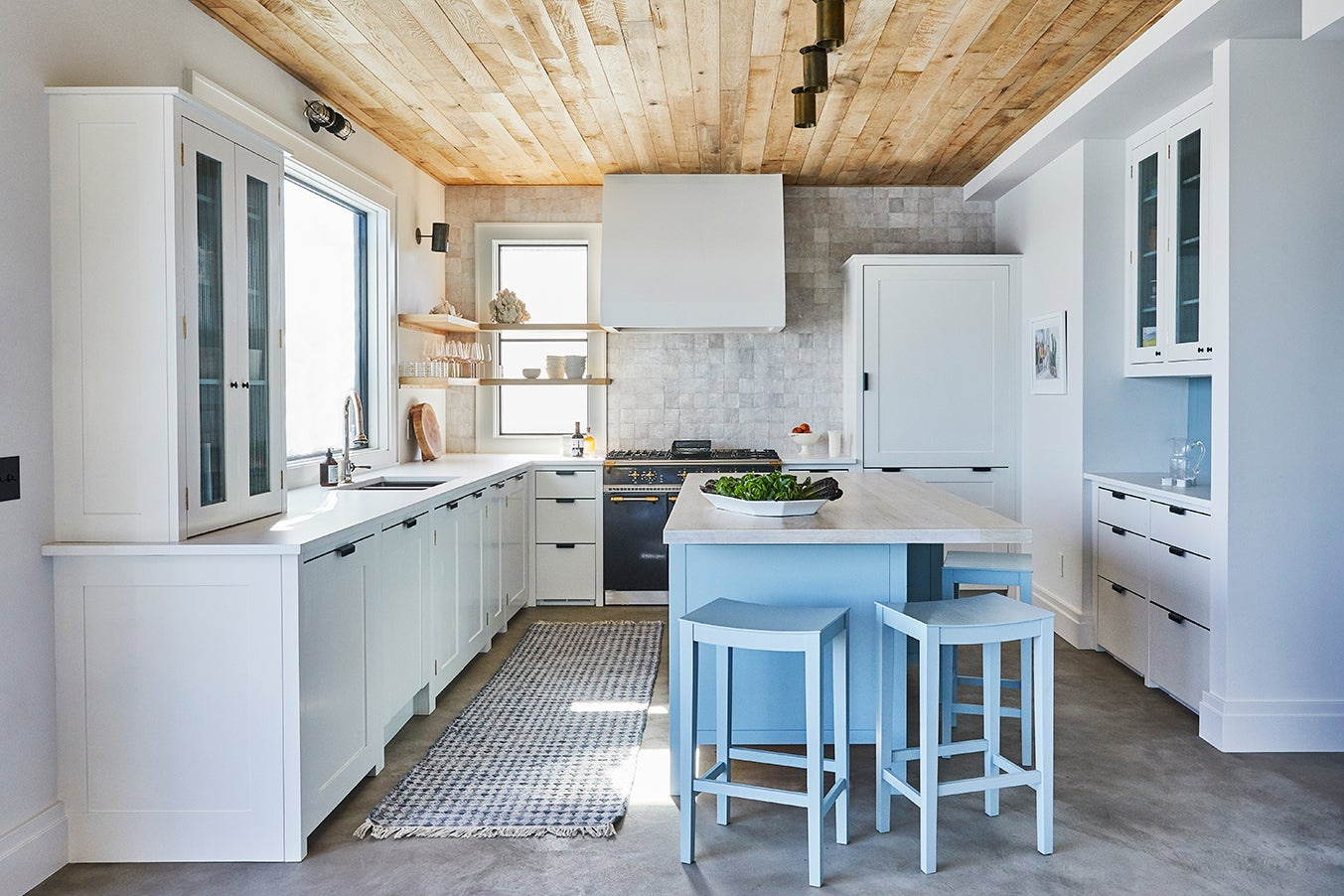 gray kitchen with baby blue island and wood ceiling