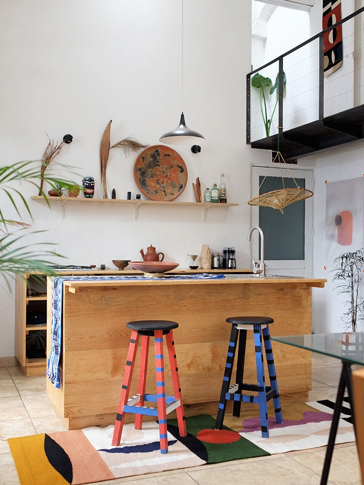wood kitchen with colorful striped stools