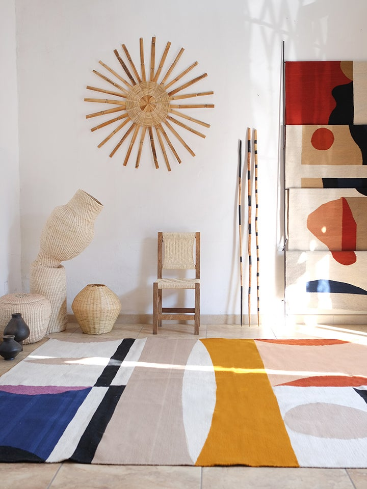 studio space with rugs and sculptures