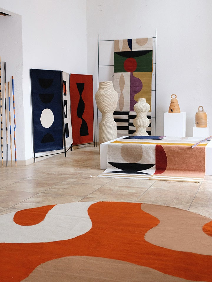 studio space with swirly orange rug