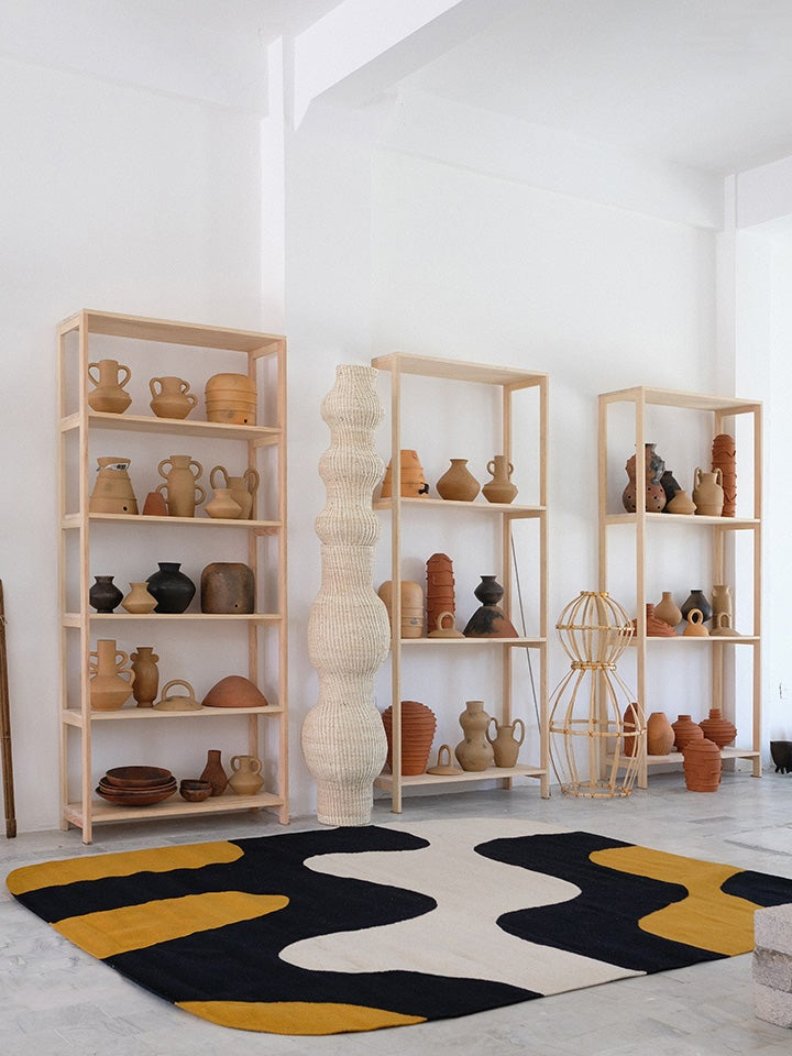 shelves of ceramics in studio space
