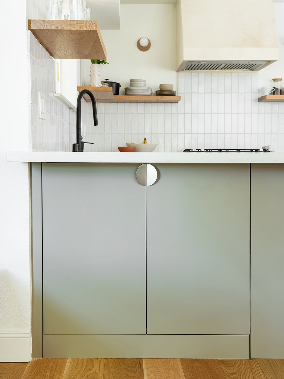 gray lower kitchen cabinet with half moon pull