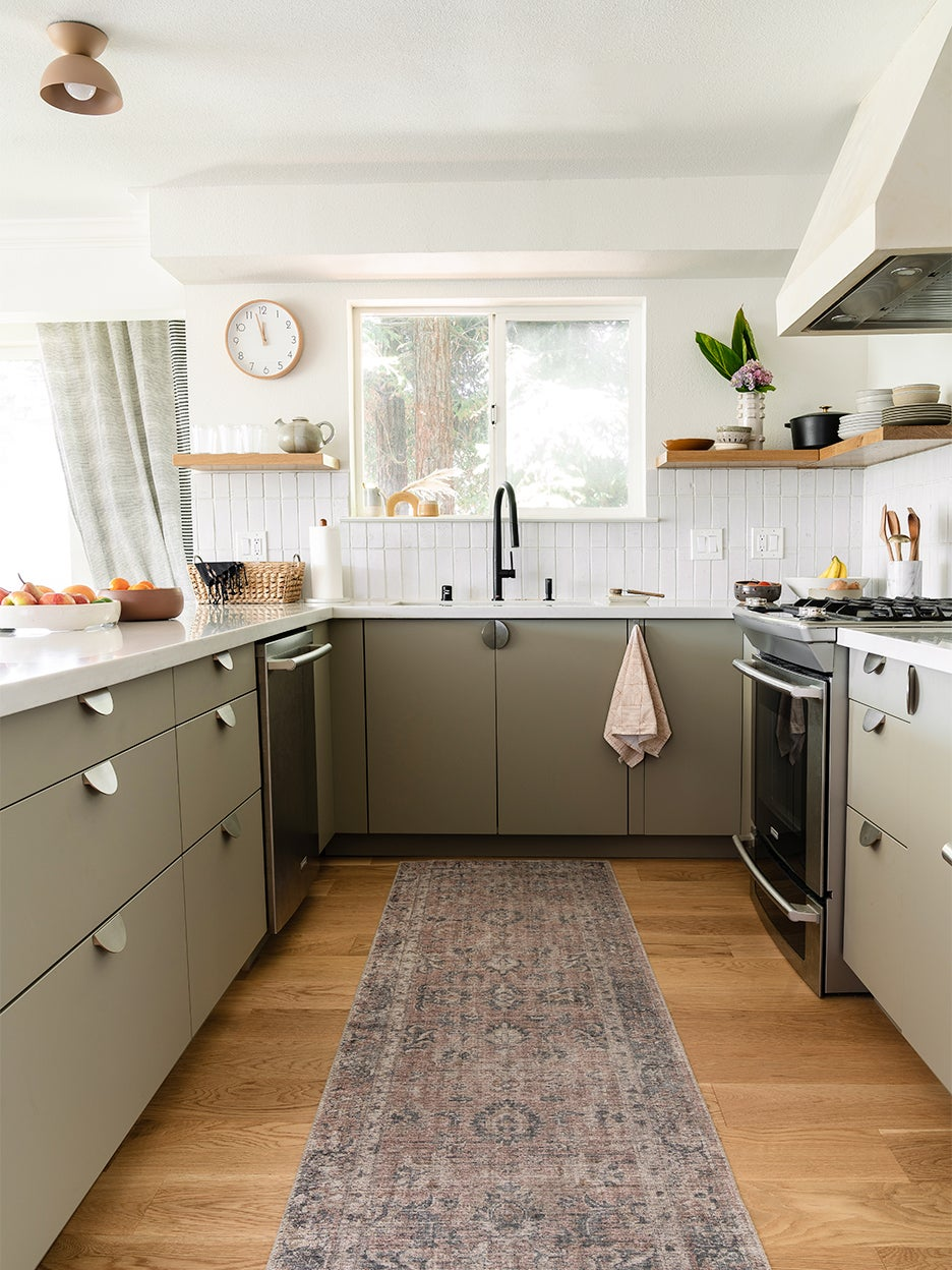 U-shaped kitchen with gray cabinets