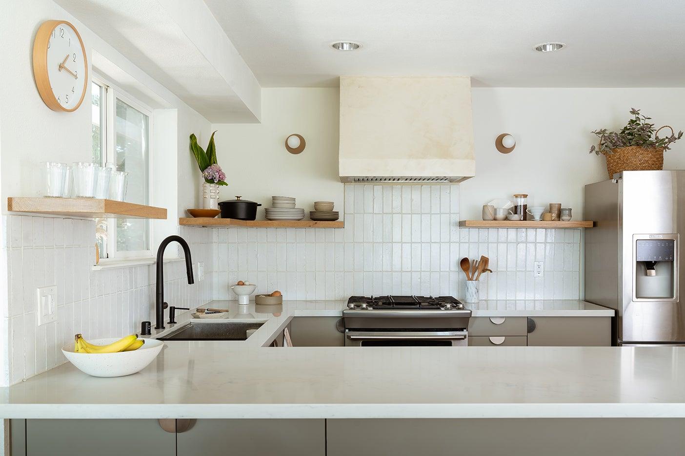 white subway tile backsplash and plaster oven hood