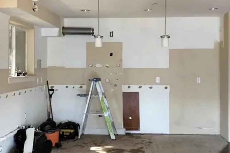 kitchen under construction with ladder