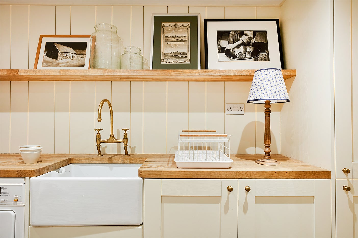 cream kitchenette with wood floating shelf
