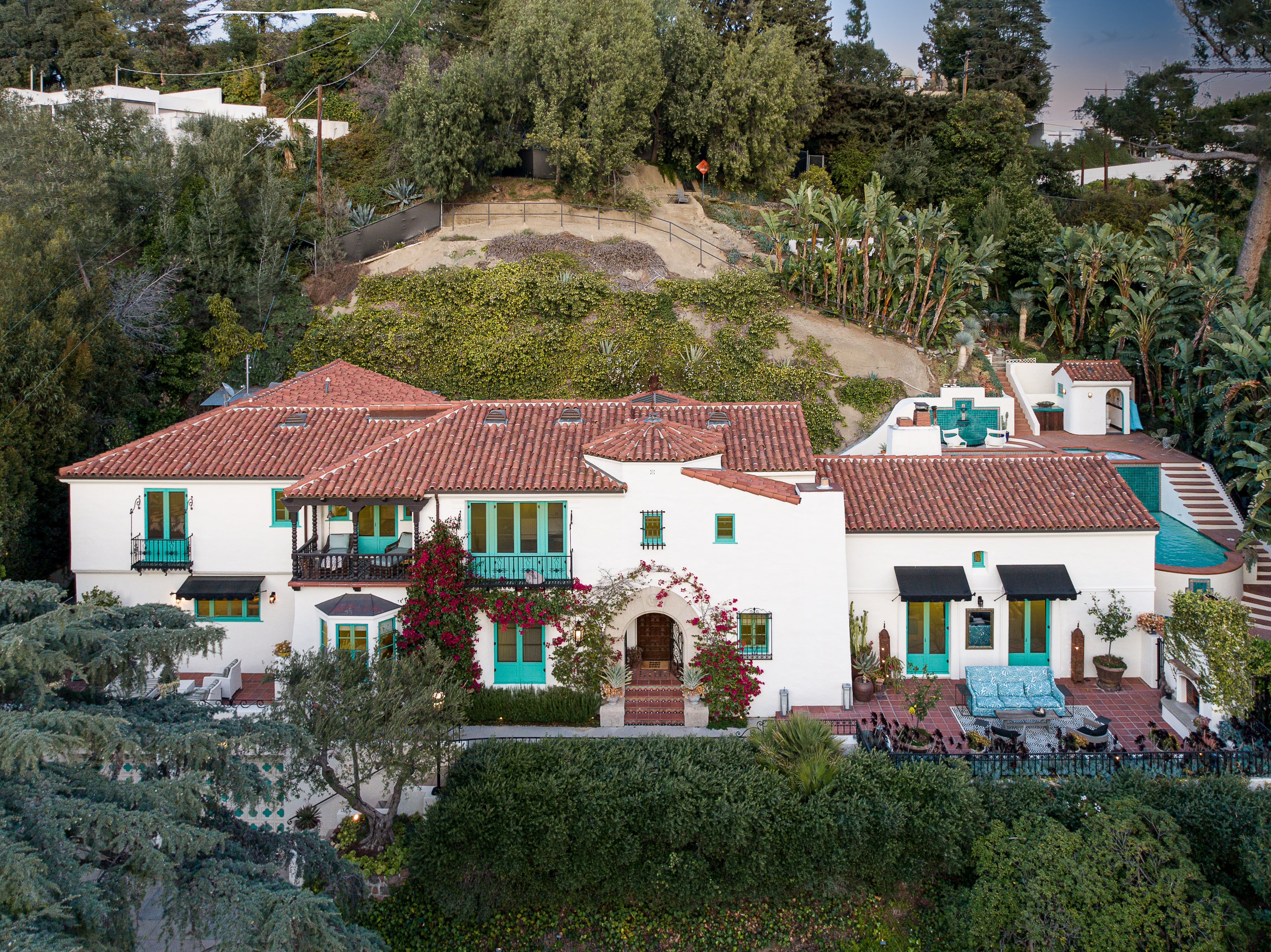 Spanish Colonial home with teal windows