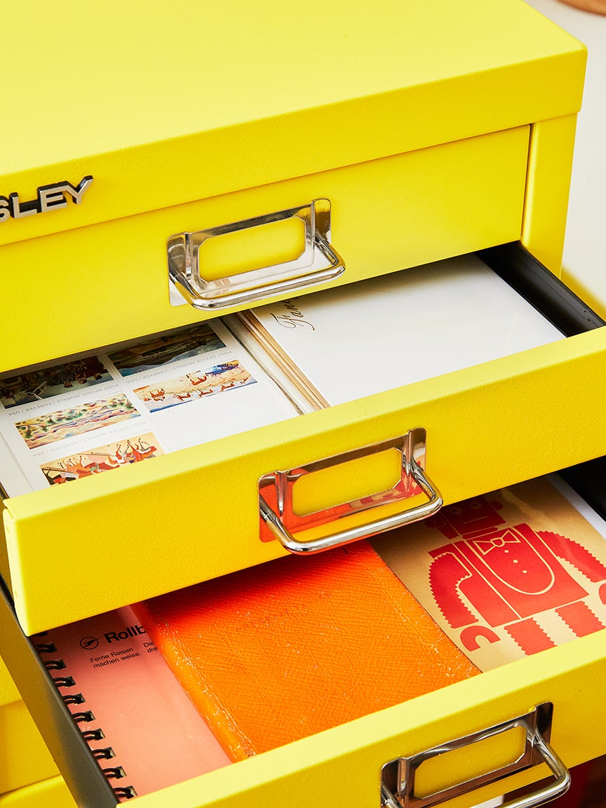 Cabinet drawers open with stationery inside