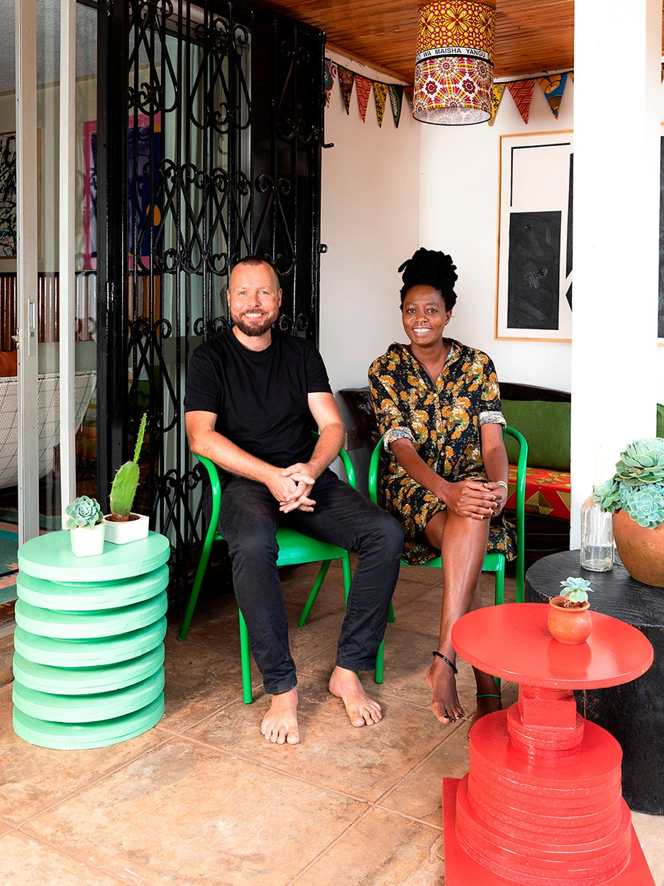 two designers sitting on colorful furniture