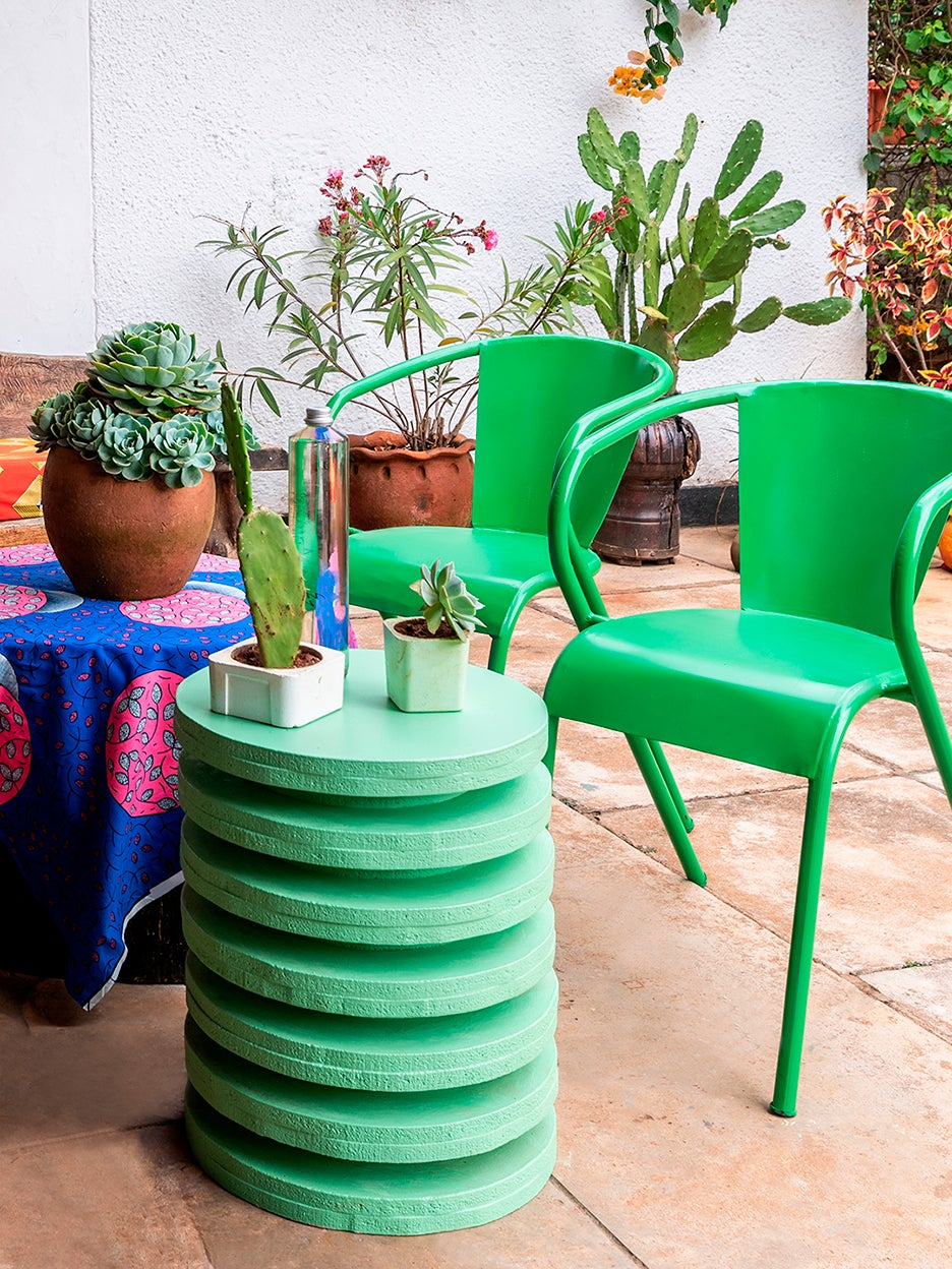 lime green chairs next to lime green stool