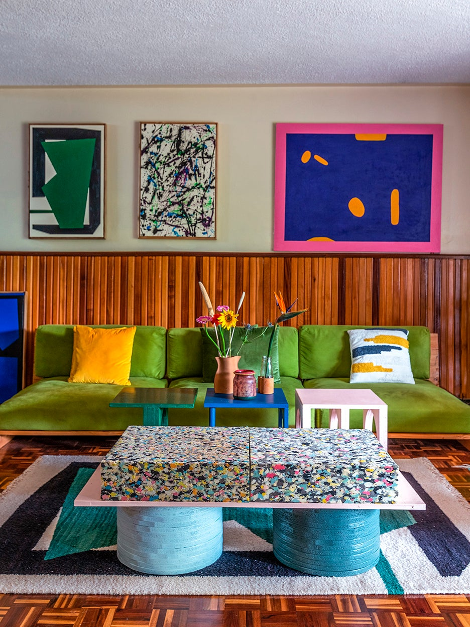 pea green velvet sofa in colorful living room