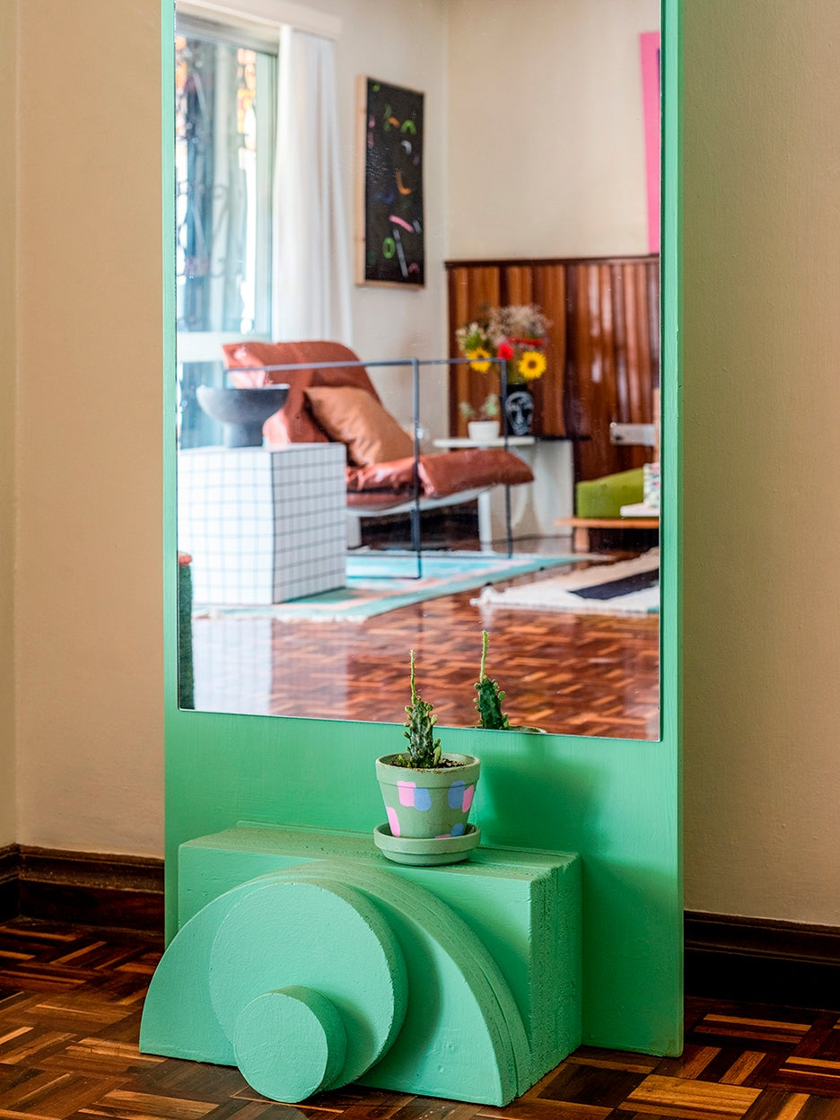 lime green floor mirror with geometric base