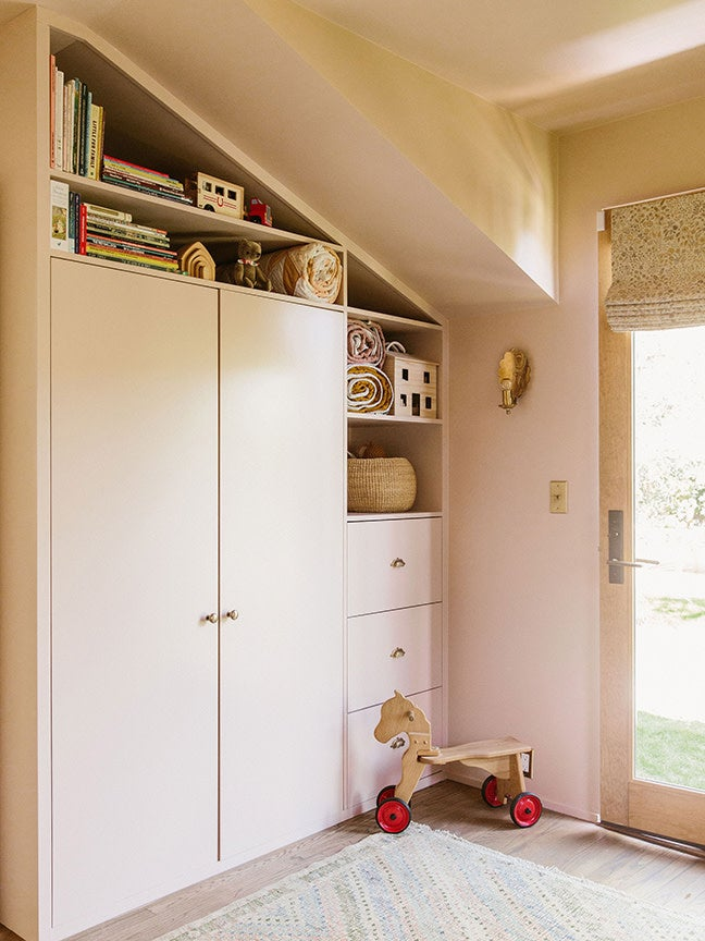 Powder pink built-in cabinets in an L.A. nursery.