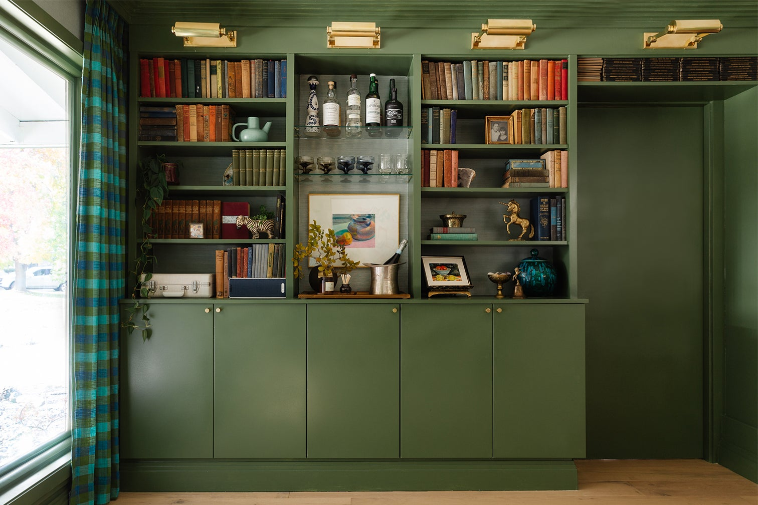 green bookcase wall
