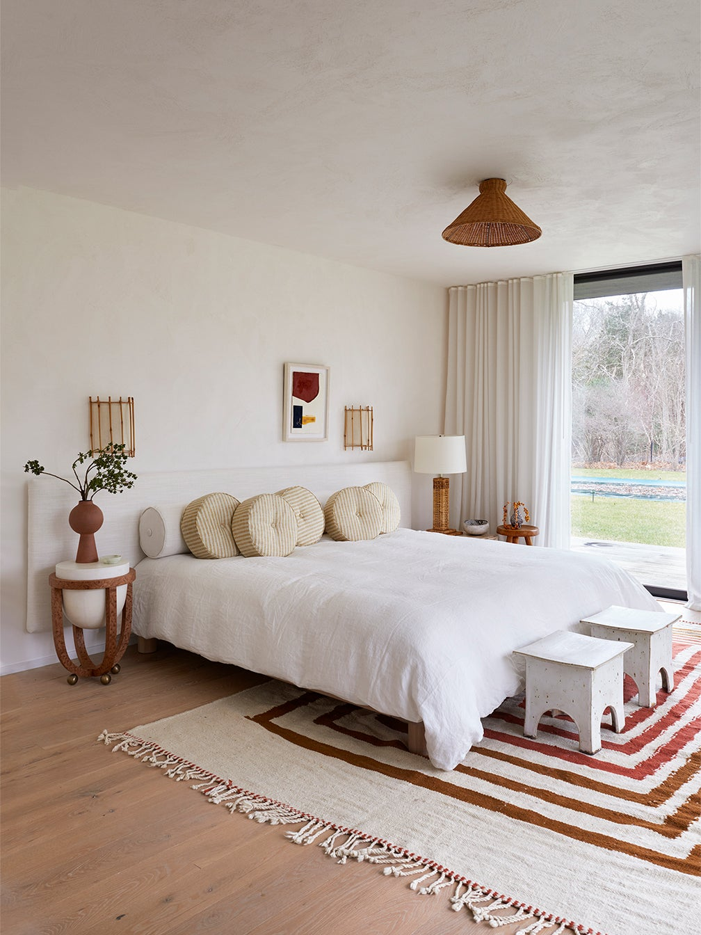modern bedroom with striped rug