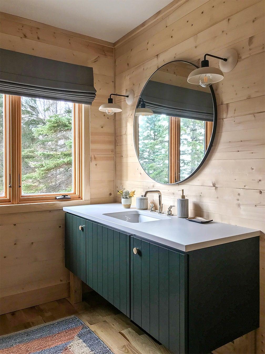 wood-paneled bathroom with green vanity