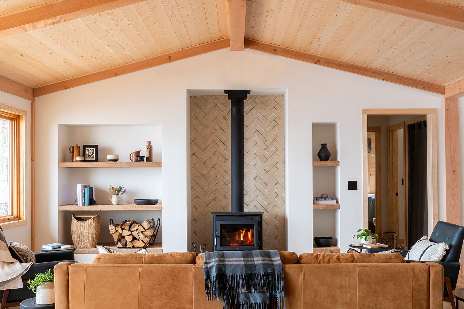 brown leather sofa facing wood-burning stove