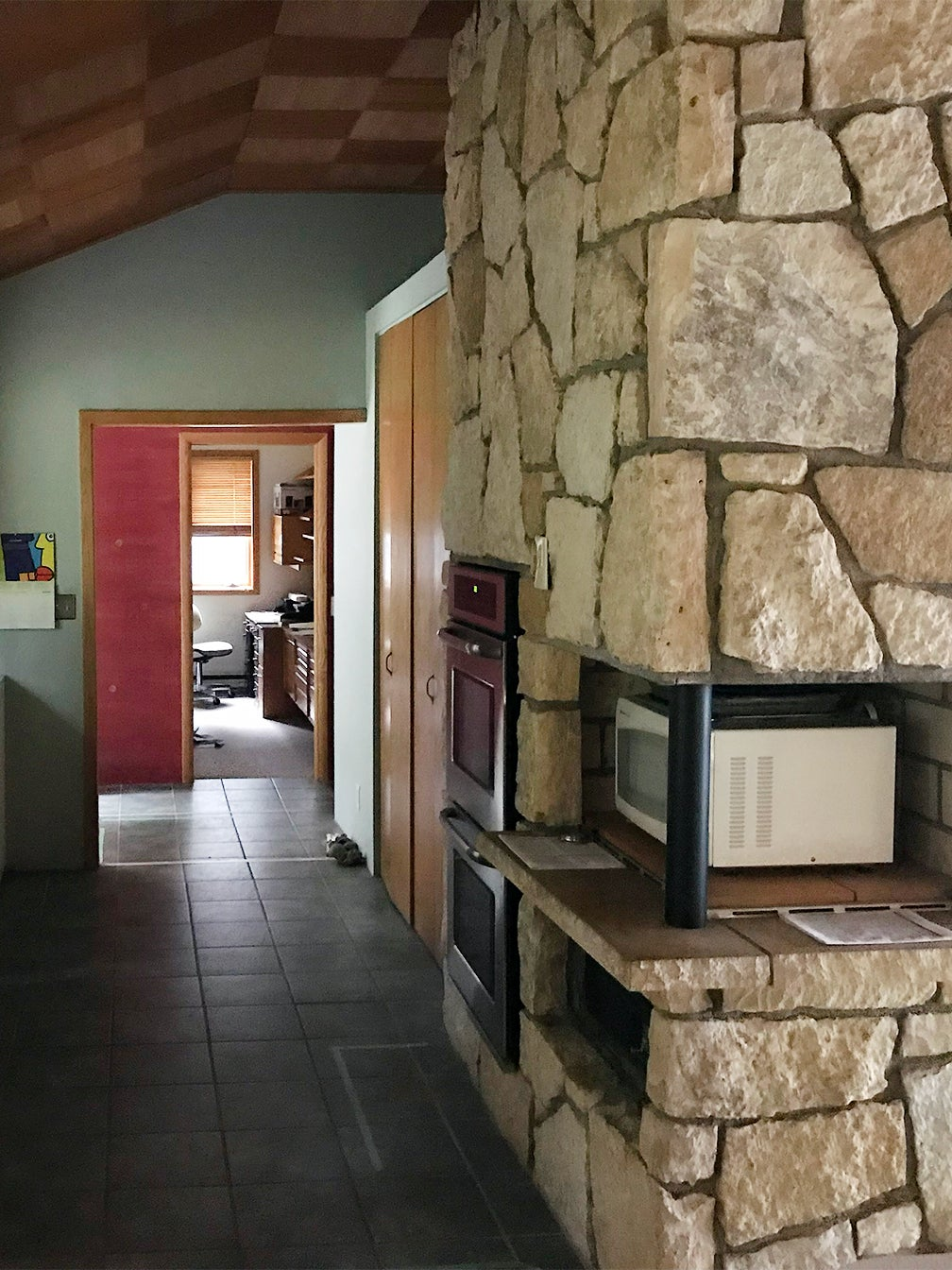 stone fireplace with microwave inset