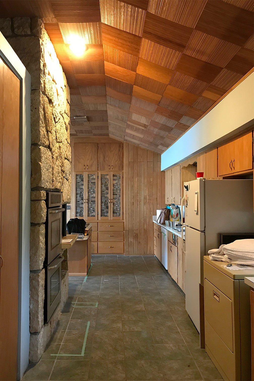 dated wood kitchen with parquet wood ceiling