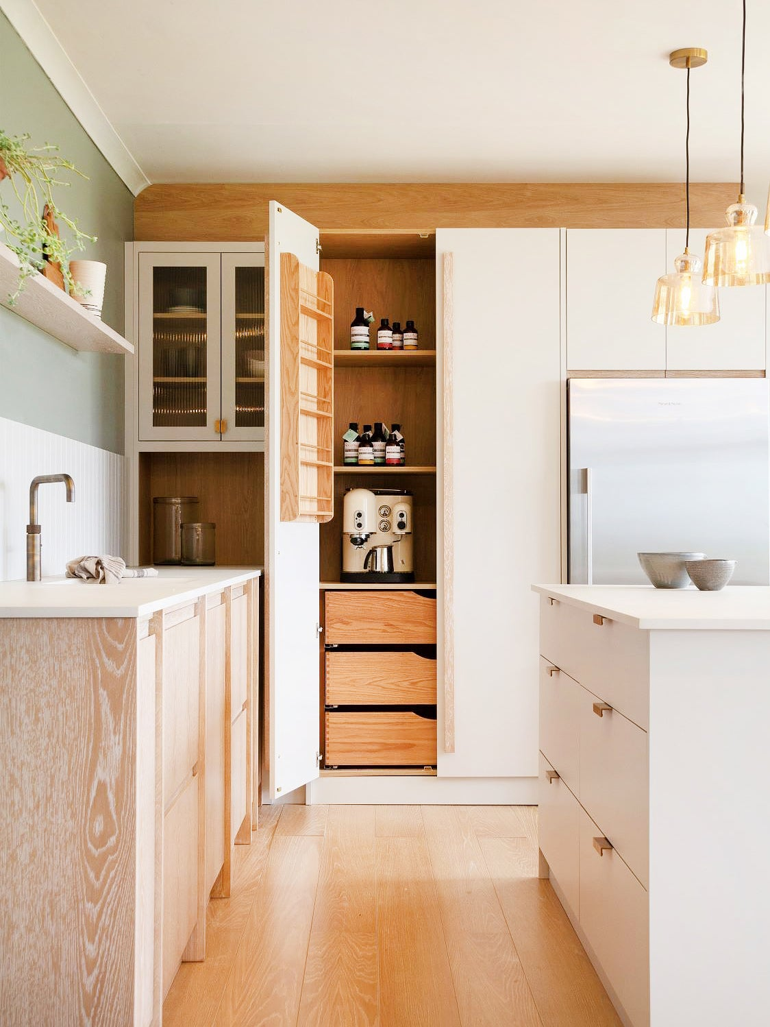 kitchen with cabinet pantry and spice ack on inside door
