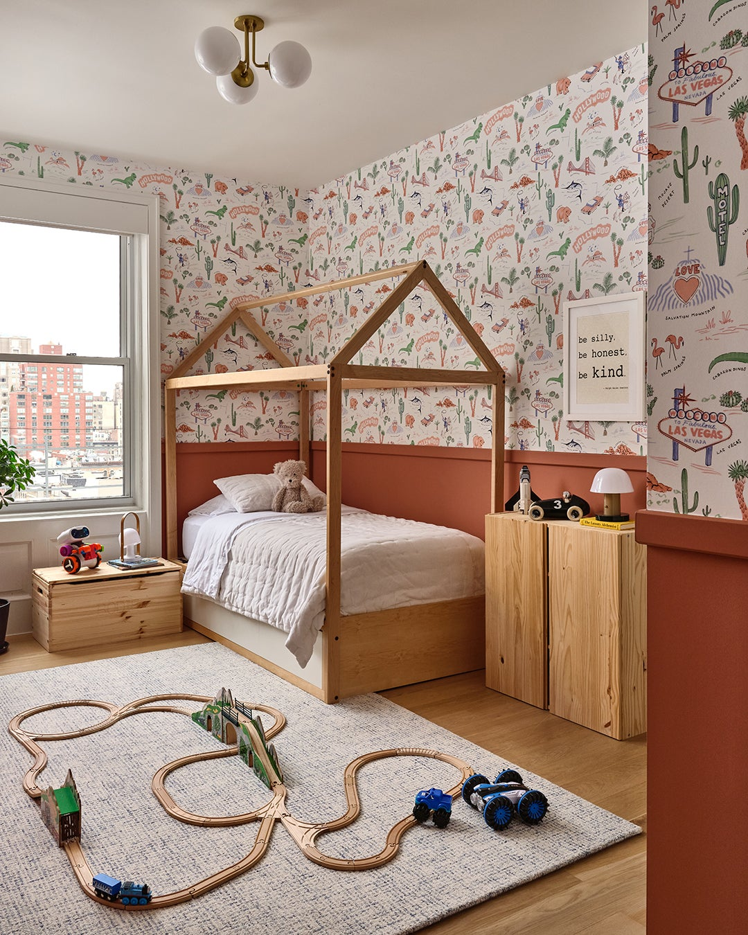 boys room with red wallpaper