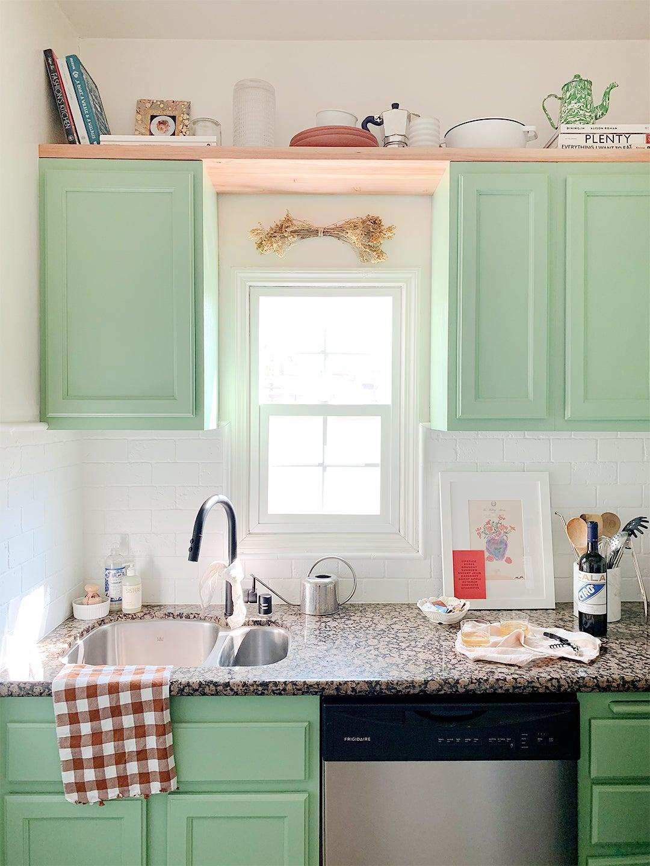wood shelf above green uppers