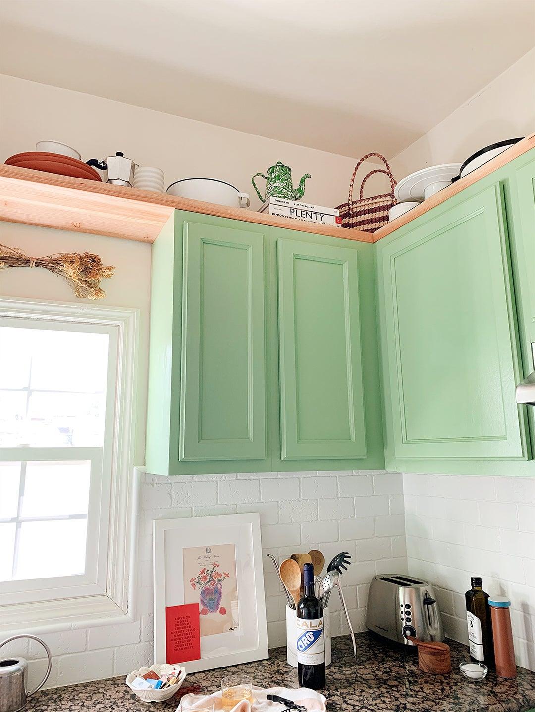 corner green cabinets