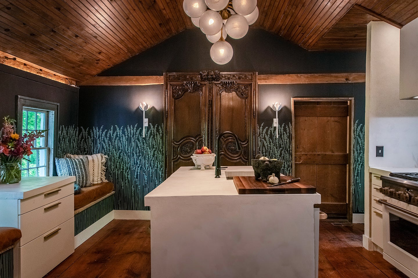 kitchen with teal wallpaper and concrete island