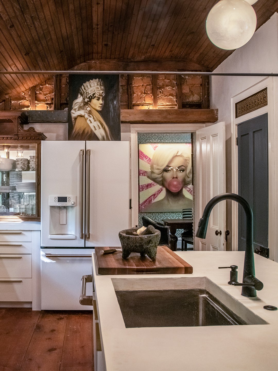 kitchen with wood ceiling and concrete island