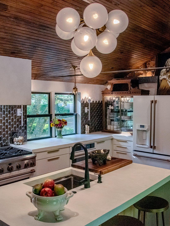 bubble pendant light above concrete kitchen island