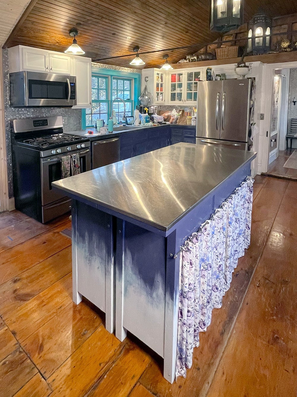kitchen with blue skirted island