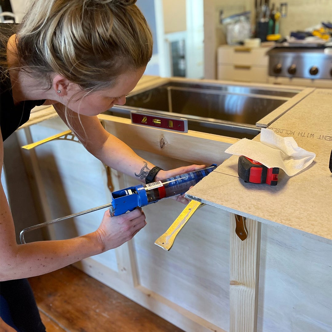 woman building kitchen island frame