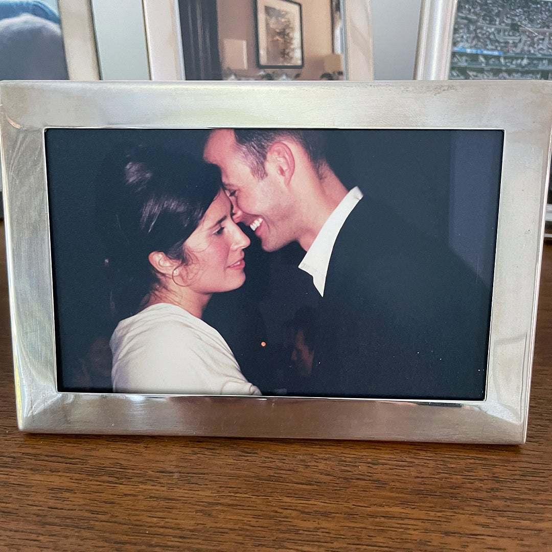 photo of couple dancing in silver frame