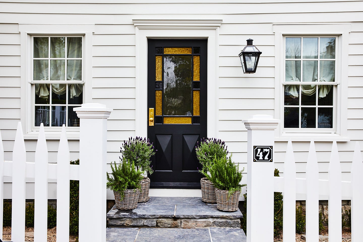 house entrance with black stained glass door