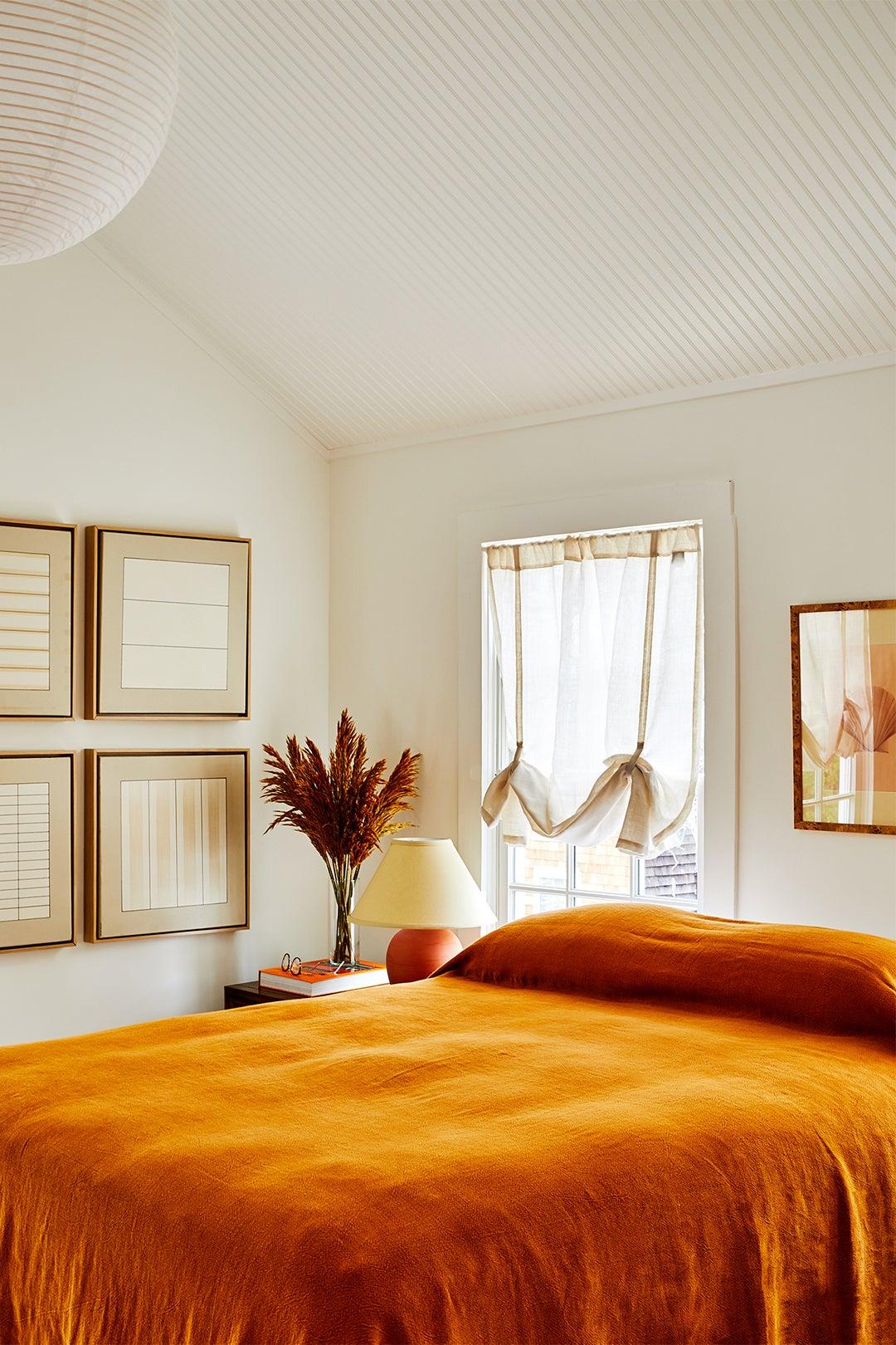 bedroom with orange duvet