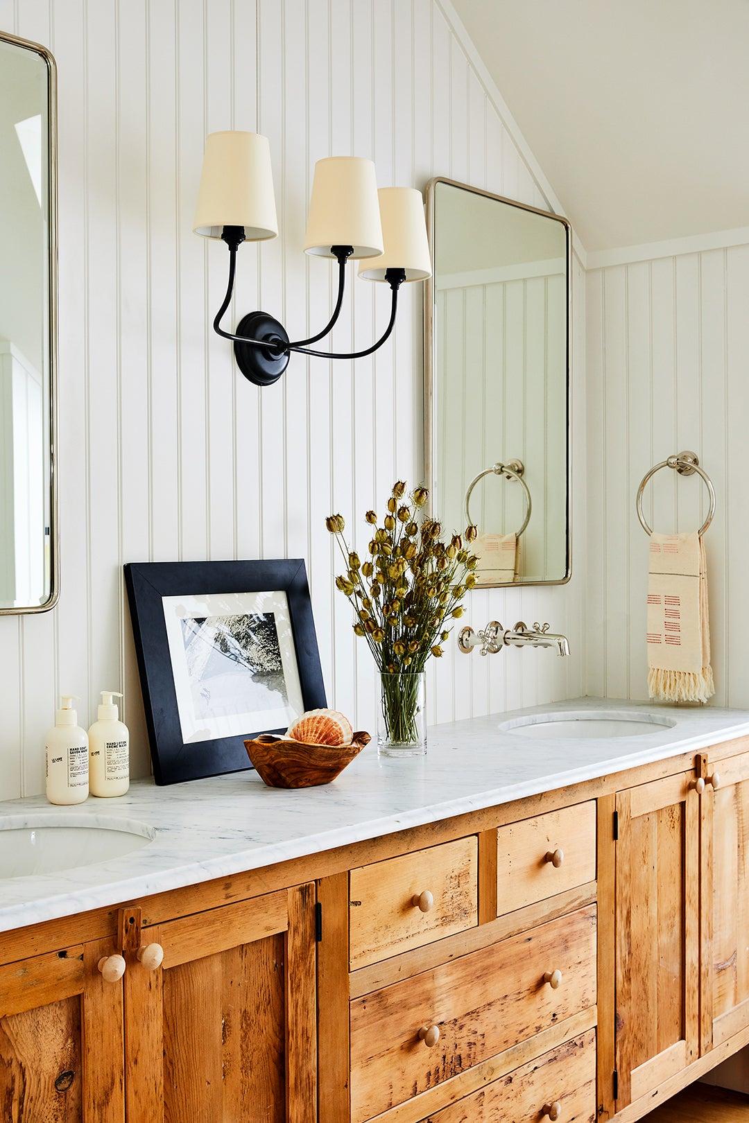 white paneled bathroom with wood vanity