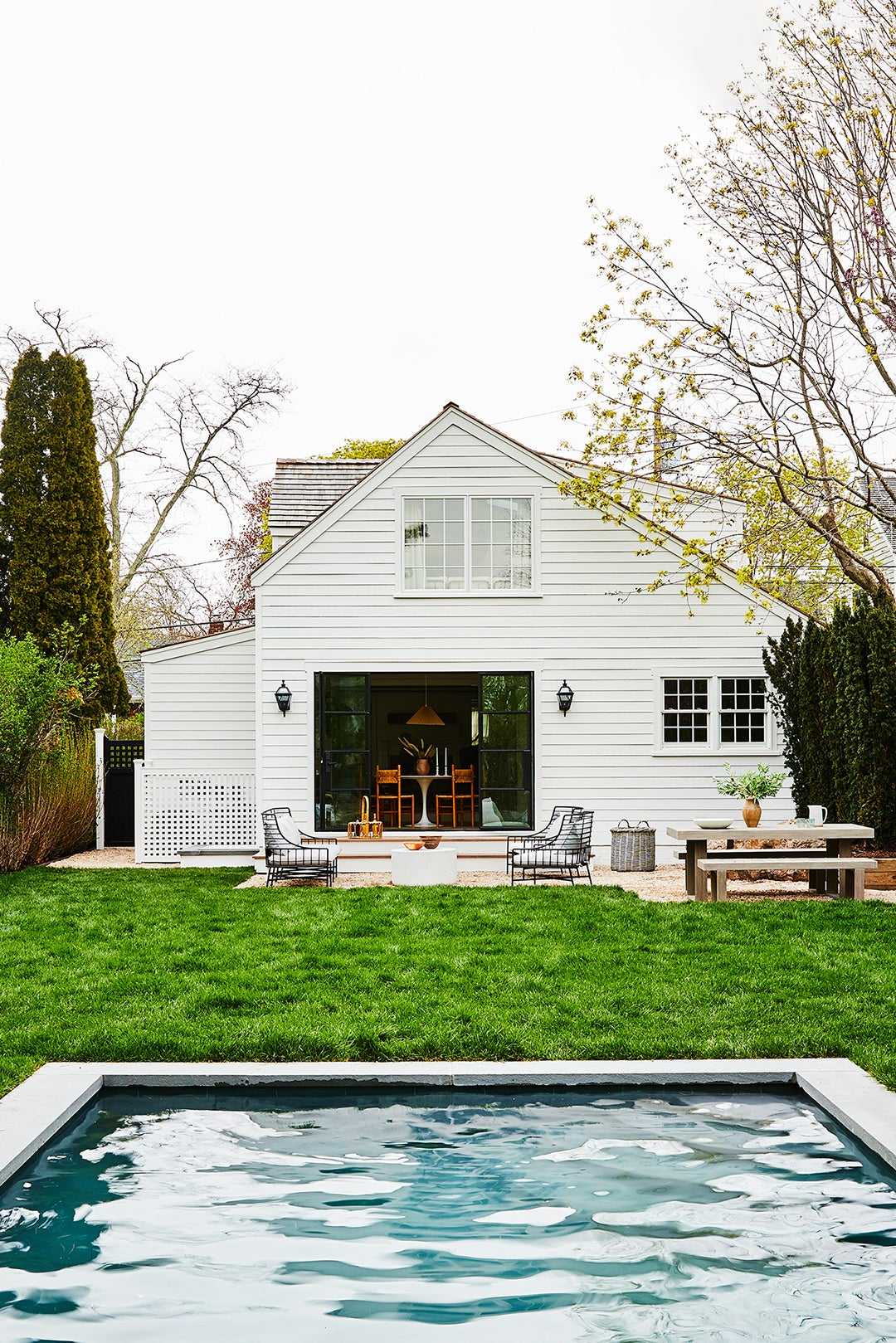 white clapboard house exterior with pool
