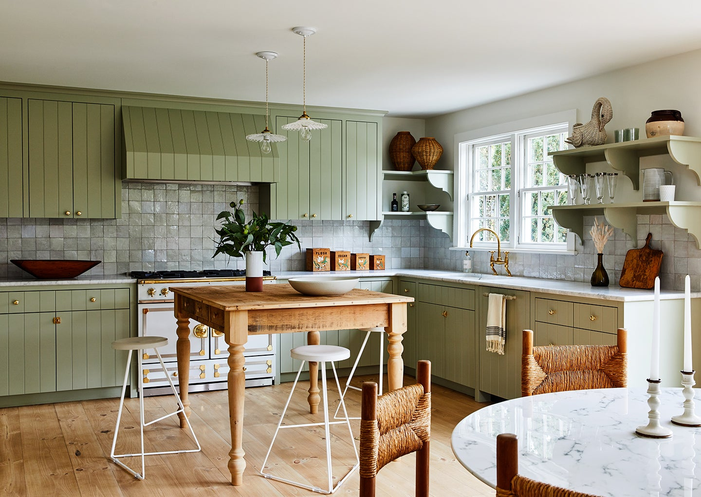 kitchen with table island and green cabinets