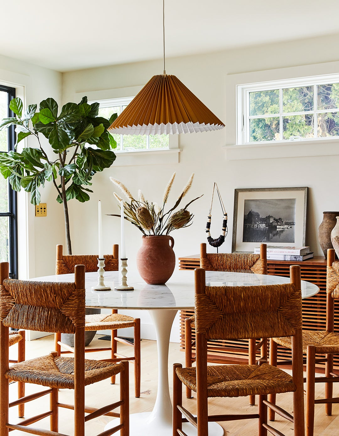dining room with woven chairs