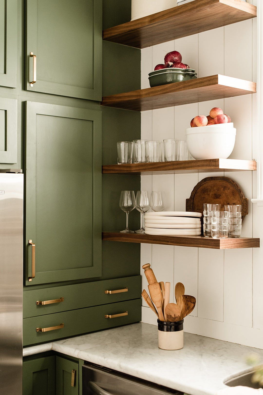 open shelves next to stacked upper cabinets