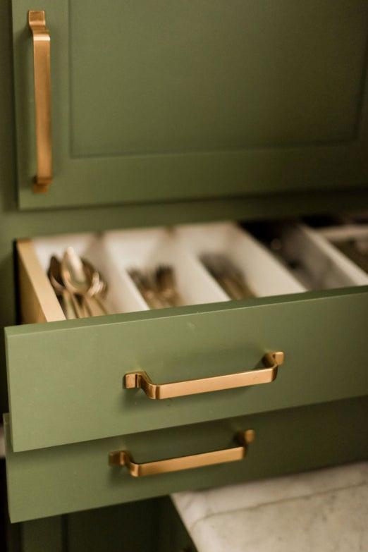flatware in upper cabinet drawers