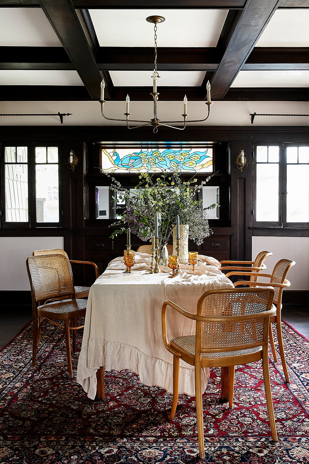 cane chairs around table