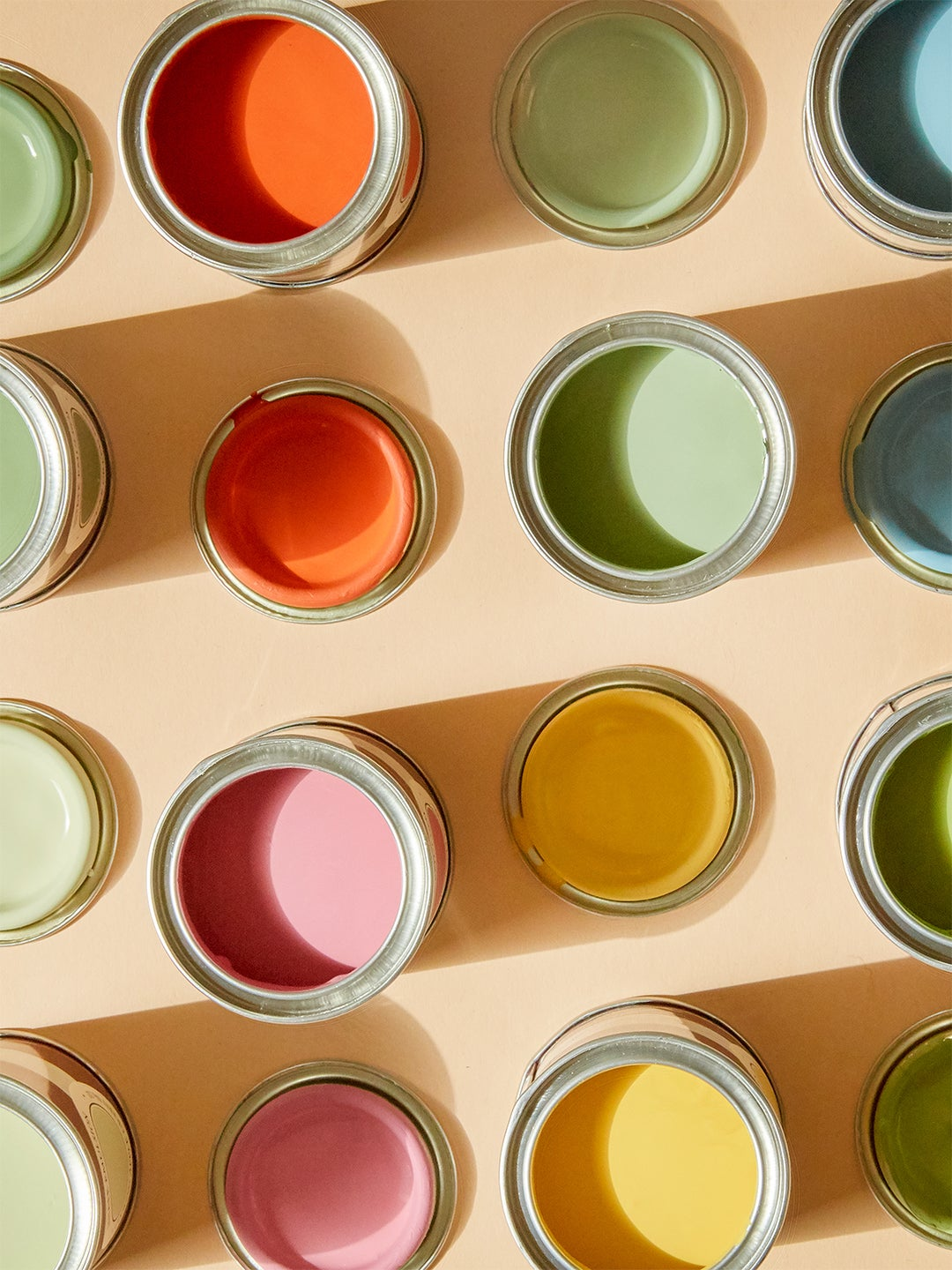 different colored open paint cans