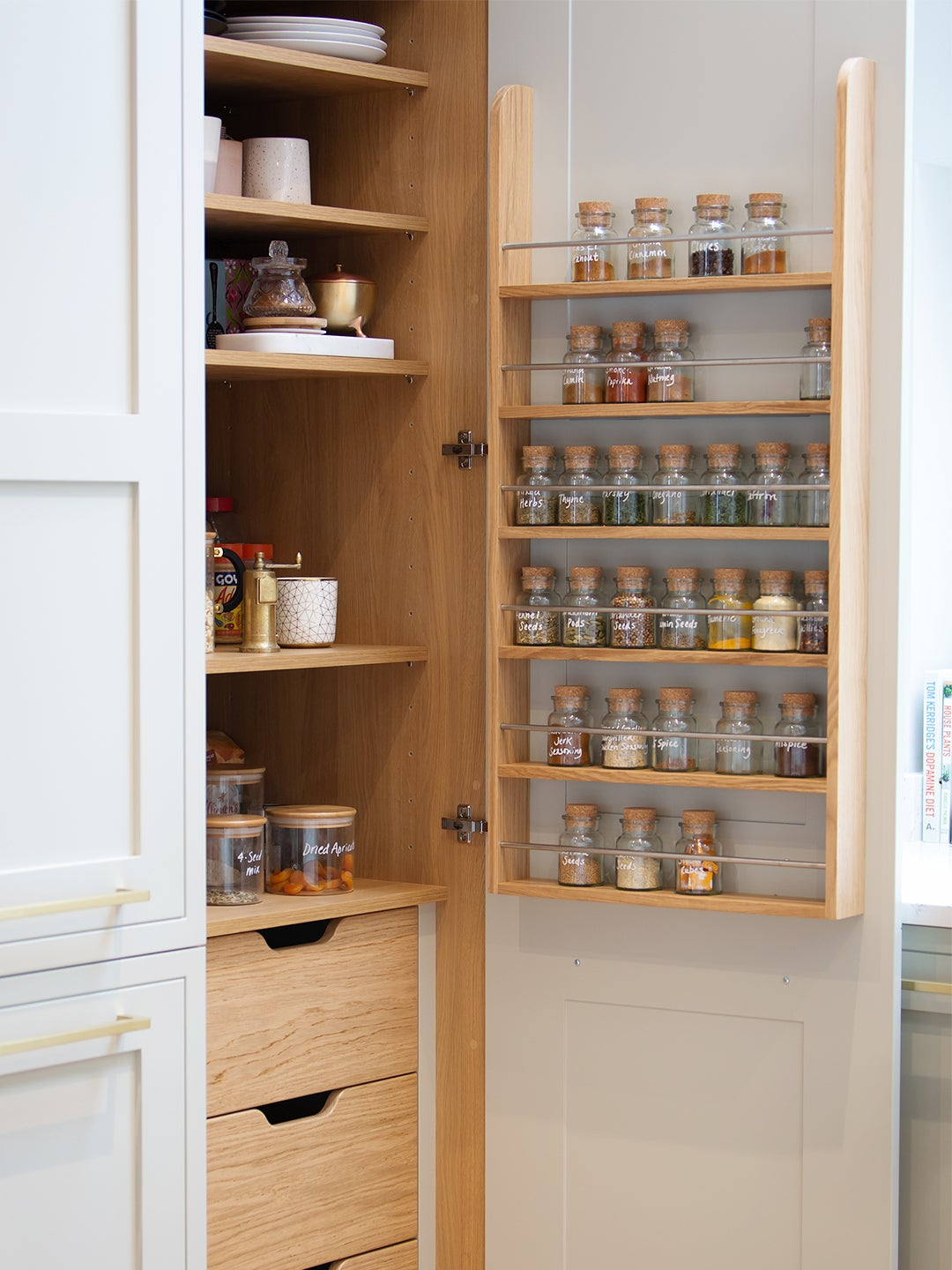 kitchen cabinet with wood spice rack on door