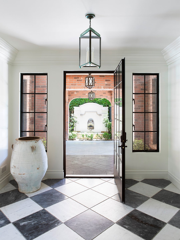 door looking onto outdoor fountain