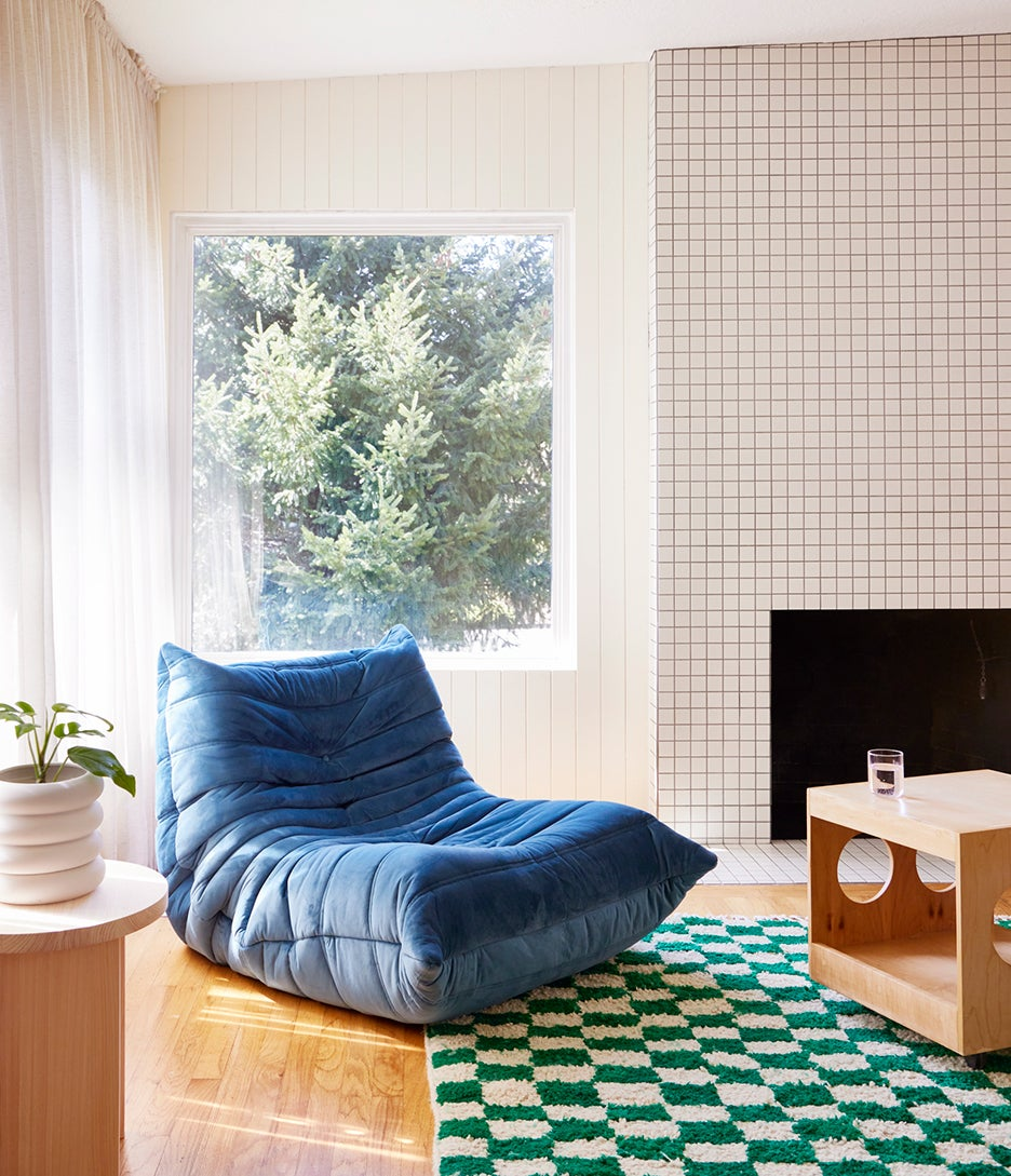 blue togo chair by window